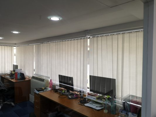 Office Room with Translucent White Vertical Blinds